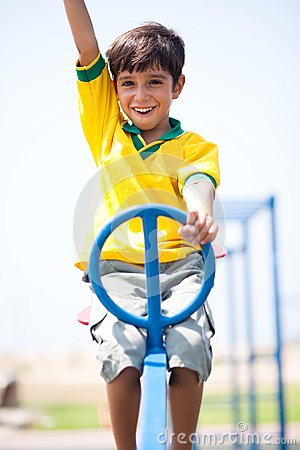 Young kid enjoying swing ride