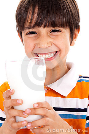 Young kid with glass of milk