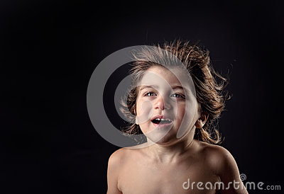 Young kid with humor expression and flying hair