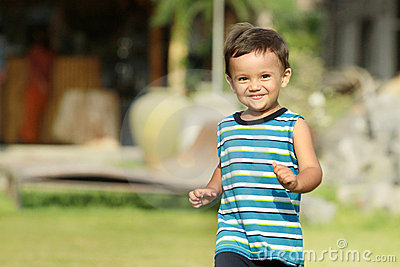 Young kid running and smiling