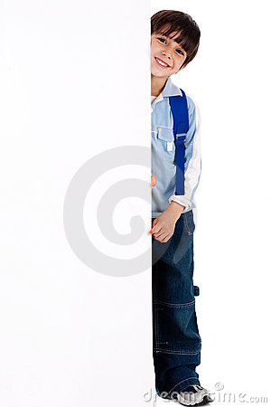 Young kid standing behind the board