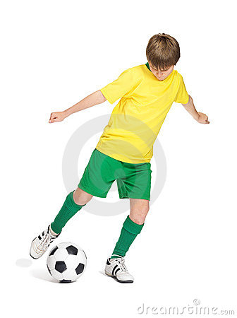 Young kid in uniform playing football