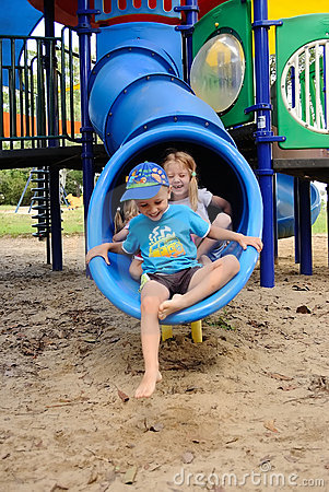 Free Young Kids Exiting A Tube Slide Royalty Free Stock Photos - 20681828
