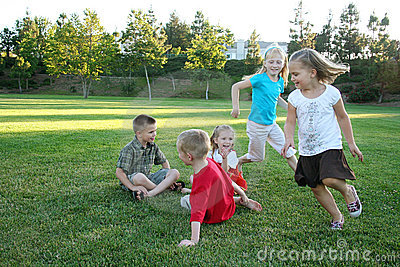 Young kids playing and running