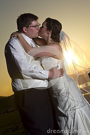 Young kissing couple on their wedding day