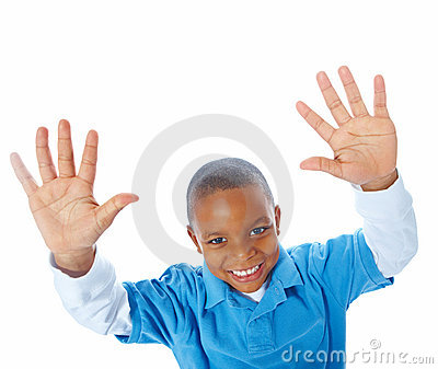 Young lad with arms raised over white background