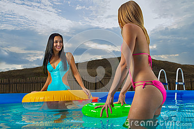 Young ladies with inflatable rings