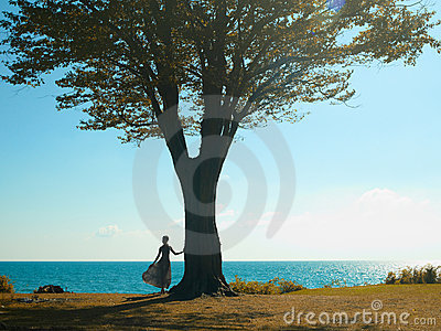 Young lady with a beautiful tree