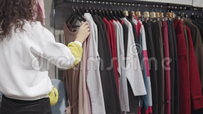 6a29a0d93cdfc Young Lady Browsing In A Shop. Stock Footage - Video of purchaser, buying:  145442488