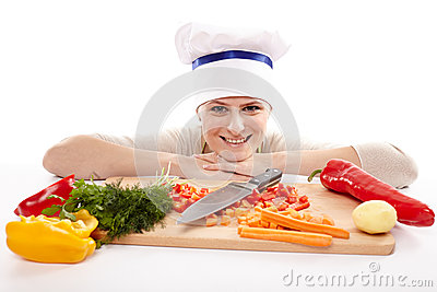 Young lady chef with chopped vegetables