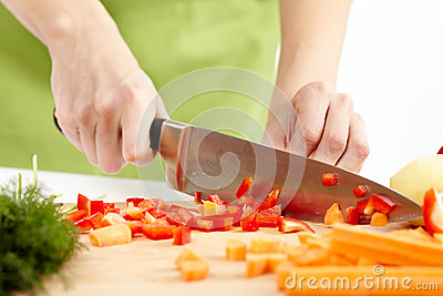 Young lady chopping vegetables