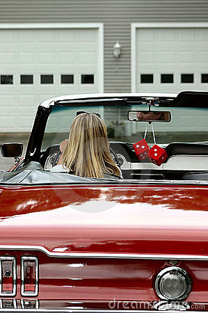 Young lady in convertible sports car
