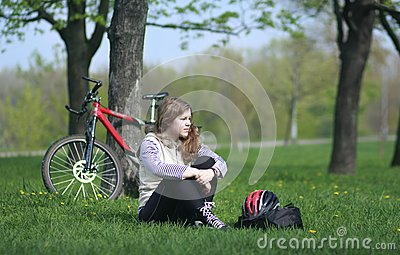 Young lady cycling in the park
