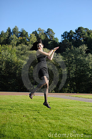 Young lady flying over lawn