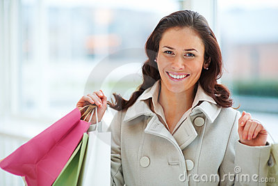 Young lady out shopping with copyspace