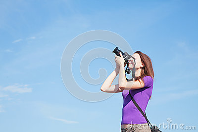 Young lady photographer outdoors