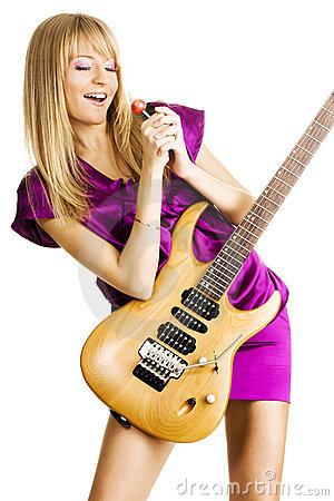 Young lady playing an electric guitar