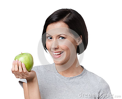 Young lady with a rape green apple