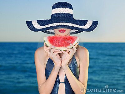 Young lady at sea with watermelon Stock Photo