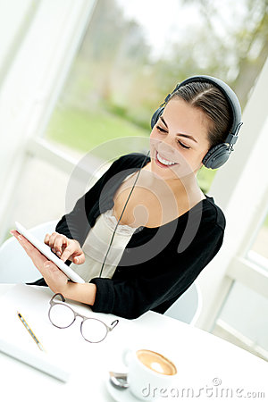 Free Young Lady Selecting A Tune From Her Music Library Royalty Free Stock Photo - 54244055
