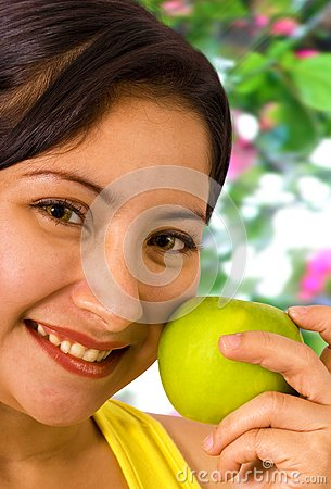 Young Lady About To Eat An Apple