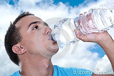 Young Latino drinking water