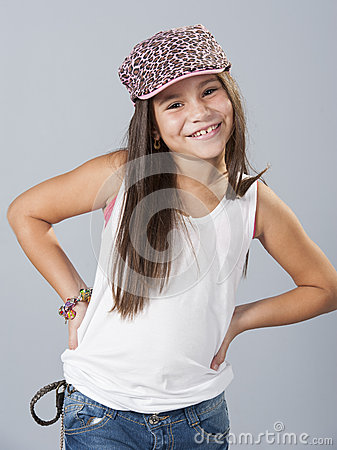 Young latino girl posing in studio