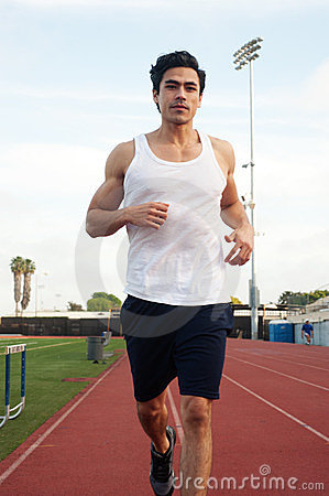 Young latino male athlete, running