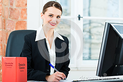 Lawyer in office making notes in a file