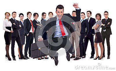 Young leader jumping for joy in front of his team