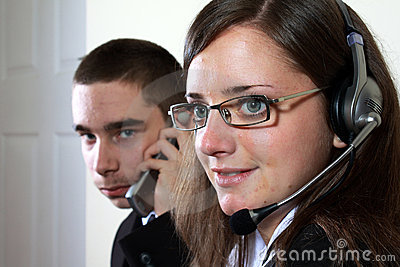 Young lefhanded boy and woman offering help desk