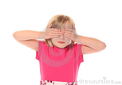 Young little girl covering eyes