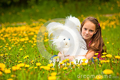 Young little girl holding a soft toy