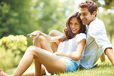 Young Loe Couple Sitting Together In Park Royalty Free Stock Image - Image: 15742066