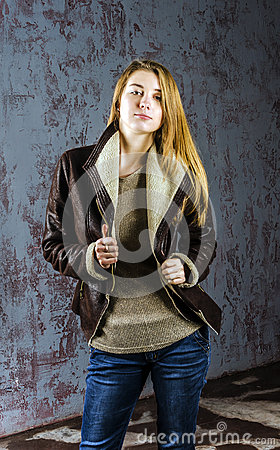 Free Young Long-haired Girl In A Leather Jacket With  Fur Collar And Jeans Stock Photos - 57071243