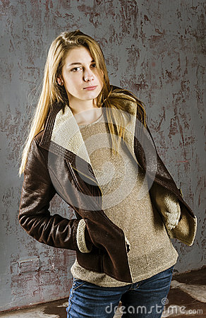 Free Young Long-haired Girl In A Leather Jacket With  Fur Collar And Jeans Royalty Free Stock Images - 57120849