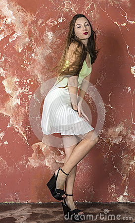 Free Young Long-haired Long-legged Skinny Girl In A Top And Skirt And Platform Sandals Royalty Free Stock Photos - 57092078