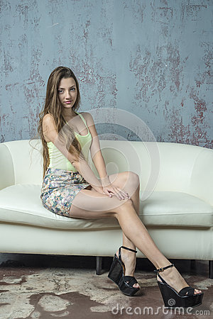 Free Young Long-haired Long-legged Skinny Girl In A Top Mini Skirt And Platform Sandals Stock Photography - 57091872