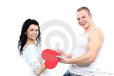 Young love couple with a big red heart