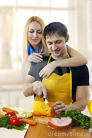 Young love couple cooking