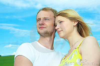 Young love couple in field