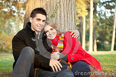 Young love couple relaxing in park