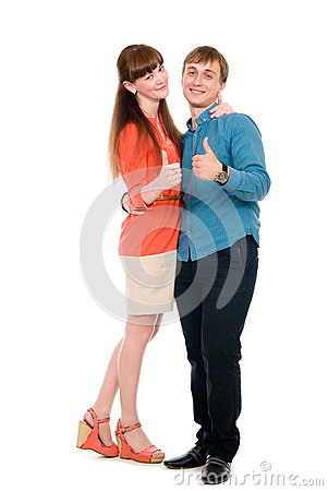 Young love couple showing thumbs up.