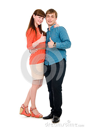 Young love couple showing thumbs up