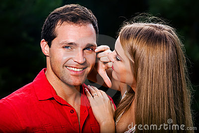 Young love couple smiling outdoors