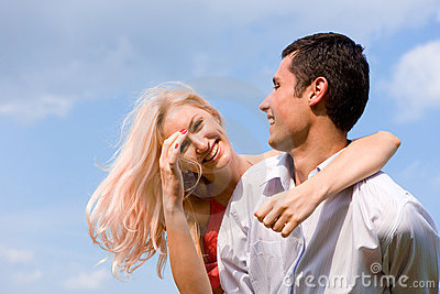Young love Couple smiling under blue sky