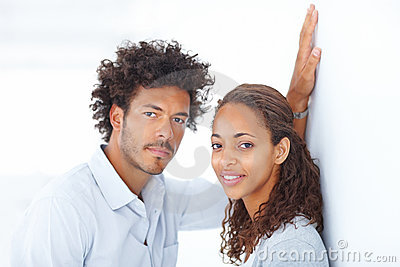 Young lovely married couple over white background