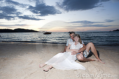 Young lovers on the beach