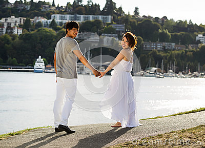 Young Lovers walking towards the Water
