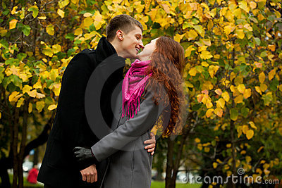 Young loving couple in autumn park
